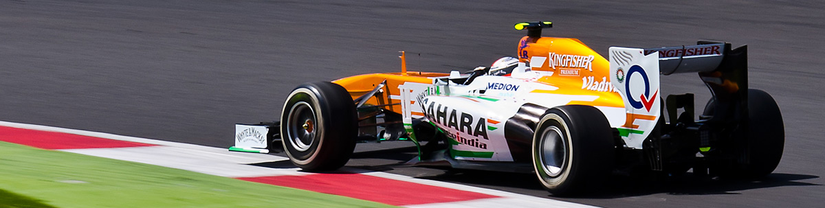 Force India through Brooklands Corner, F1 Silverstone 2013