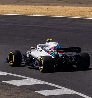 Williams F1 car rounds Brooklands in 2018 (c) Simon PR Benson